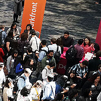 crowd of students and employers at a career fair